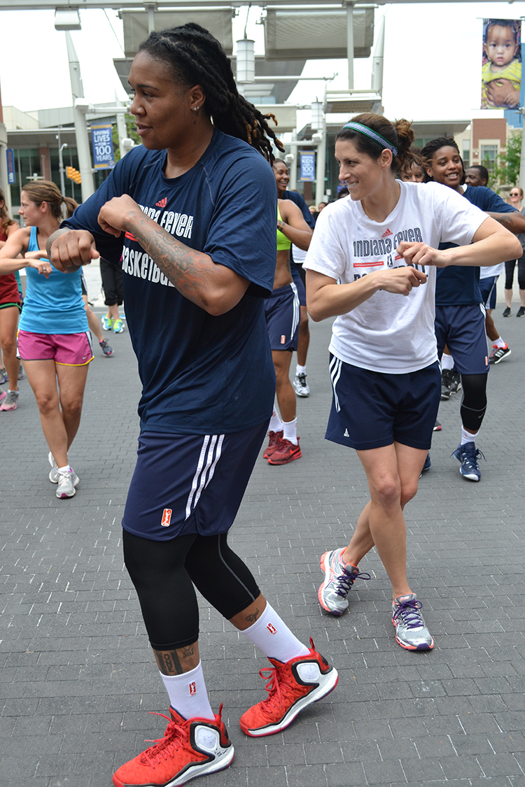 Erlana Larkins and Coach White dance during Workout Wednesday
